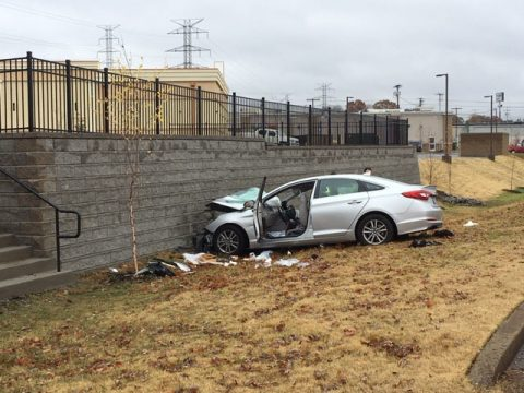 Hyundai Sonata leaves roadway and crashes into retaining wall near Governor's Square Mall Sunday.