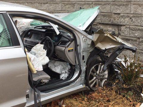 Hyundai Sonata leaves roadway and crashes into retaining wall near Governor's Square Mall Sunday.