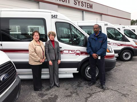 Clarksville Mayor Kim McMillans stands long side the new Clarksville Transit System Paratransit Vehicles.