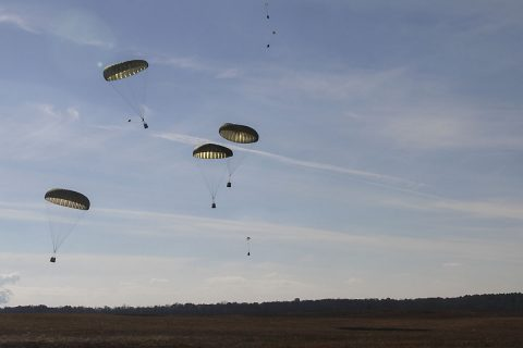 Parachute bundles drift in the sky before landing on Suckchon Drop Zone, Dec. 7, 2016, during airdrop training on Fort Campbell, KY Soldiers from 74th Transportation Company, 129th Combat Sustainment Support Battalion, 101st Airborne Division (Air Assault) Sustainment Brigade, 101st Abn. Div., and 861st Quartermaster Company, a reserve unit from Nashville, TN, unit to conduct aerial delivery and recovery training. (Sgt. Neysa Canfield/101st Airborne Division Sustainment Brigade Public Affairs)