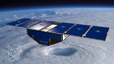 Artist's concept of one of the eight NASA Cyclone Global Navigation Satellite System satellites deployed in space above a hurricane. (NASA)