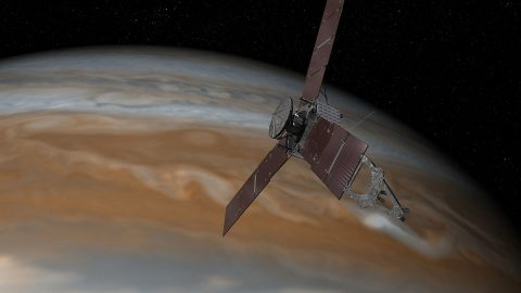 This artist's rendering shows NASA's Juno spacecraft making one of its close passes over Jupiter. (NASA/JPL-Caltech)
