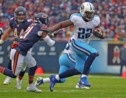 Tennessee Titans running back Derrick Henry (22) runs past Chicago Bears cornerback Tracy Porter (21) during the second quarter at Soldier Field. (Dennis Wierzbicki-USA TODAY Sports)