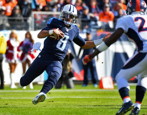 Tennessee Titans quarterback Marcus Mariota (8) slides for a first down during the first half against the Denver Broncos at Nissan Stadium. (Christopher Hanewinckel-USA TODAY Sports)