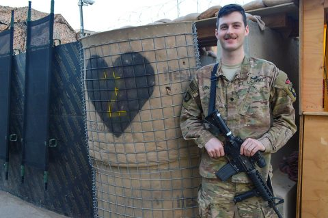 Spc. Erik Salmon, 26, an intelligence analyst assigned to the 2nd Brigade Combat Team, 101st Airborne Division, poses for a photograph while deployed in support of Operation Inherent Resolve, at Camp Swift, Jan. 8, 2017. Salmon assisted in the recovery of an isolated Iraqi Security Forces (ISF) soldier while working as a member of a U.S. and Iraqi advise and assist operations cell. (Maj. Ireka R. Sanders)