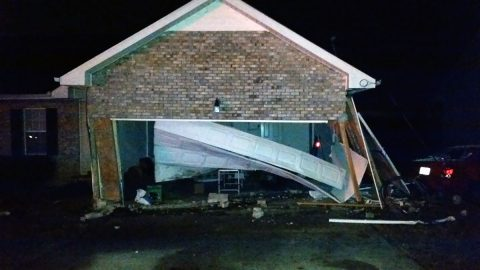 Vehicle leaves roadway and crashes into house on Meredith Way early Sunday morning.