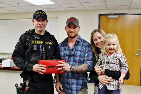 Drew Estell donates a Shot Indicating Resetting Trigger (SIRT) Training Pistol to the Montgomery County Sheriff's Office.