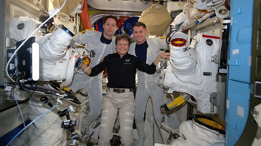 Astronaut Peggy Whitson (center) helps spacewalkers Thomas Pesquet (left) and Shane Kimbrough suit up before beginning their spacewalk Jan. 13, 2017. (NASA)