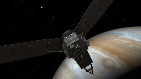 This illustration depicts NASA's Juno spacecraft at Jupiter, with its solar arrays and main antenna pointed toward the distant sun and Earth. (NASA/JPL-Caltech)