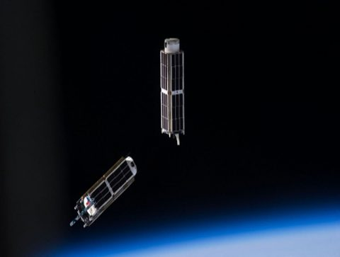A set of NanoRacks CubeSats is photographed by an Expedition 38 crew member after the deployment by the NanoRacks Launcher attached to the end of the Japanese robotic arm. The CubeSats program contains a variety of experiments such as Earth observations and advanced electronics testing. (NASA)