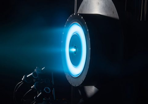 This image shows a cutting-edge solar-electric propulsion thruster in development at NASA's Jet Propulsion Laboratory, Pasadena, Calif., that uses xenon ions for propulsion. An earlier version of this solar-electric propulsion engine has been flying on NASA's Dawn mission to the asteroid belt. This engine is being considered as part of the Asteroid Initiative, a proposal to robotically capture a small near-Earth asteroid and redirect it safely to a stable orbit in the Earth-moon system where astronauts can visit and explore it. This image was taken through a porthole in a vacuum chamber at JPL where the ion engine is being tested.