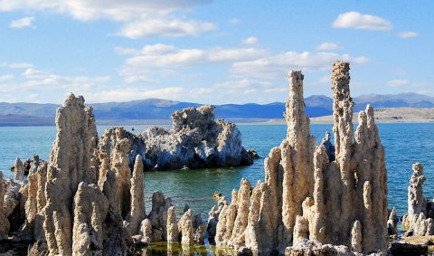 "Mono Lake, California, with salt pillars known as ""tufas"" visible. JPL scientists tested new methods for detecting chemical signatures of life in the salty waters here, believing them to be analogs for water on Mars or ocean worlds like Europa. (Mono County Tourism)"