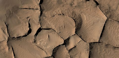 This view from the HiRISE camera on NASA's Mars Reconnaissance Orbiter shows part of an area on Mars where narrow rock ridges, some as tall as a 16-story building, intersect at angles forming corners of polygons. (NASA/JPL-Caltech/Univ. of Arizona)