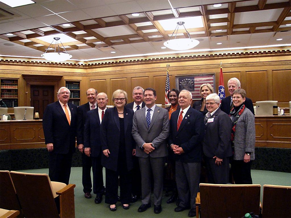 Speaker Pro Tempore Curtis Johnson, Senator Mark Green and President of Austin Peay Alisa White with members of the Austin Peay University Board.