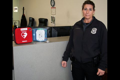Lori McNulty, security officer at Clarksville City Hall, displays one of the automated external defibrillators, or AEDs, available at the City's downtown facilities to help counter the risks associated with sudden cardiac emergencies.
