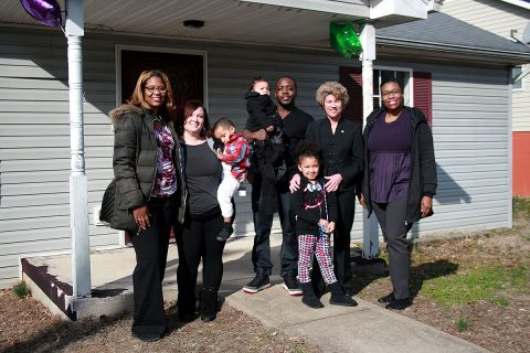 Clarksville Mayor Kim McMillan greets the Lee family, Chasity, Vincent, Za'Den, Kay'Lisa and La'Miyah as they prepare to move into a new home provided by Flourishing Families, a Clarksville social service agency.