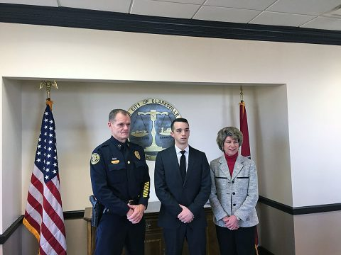 Chief Al Ansley, Brendan Davis, Clarksville Mayor Kim McMillan