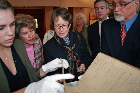 Kali Mason, Customs House Curator of Collections, carefully handles pages of the diary of Serepta Jordon as Mayor Kim McMillan, Millie Armstrong, Tenessee Secretary of State Tre Hargett and Customs House Executive Director Jim Zimmer look at the fragile document. Hargett delivered a $3,000 state grant check to the museum Thursday that will be used to continue the restoration of the historic diary.