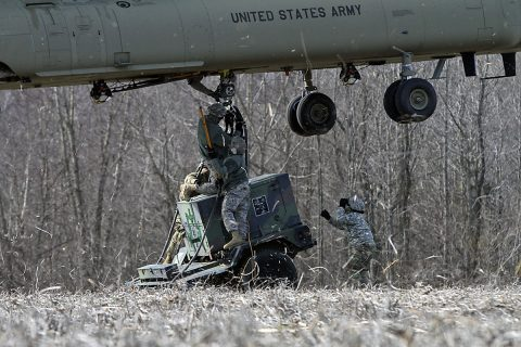 Soldiers from 58th Signal Company, 101st Special Troops Battalion, 101st Airborne Division (Air Assault) Sustainment Brigade, 101st Abn. Div., attach a 10k generator to a CH-47 Chinook helicopter during the company's sling load operation Feb. 10, 2017, on Fort Campbell, Kentucky. (Sgt. Neysa Canfield/101st Airborne Division Sustainment Brigade Public Affairs)