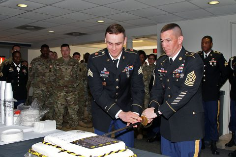 Sgt. Travis Bertovich, left, an intelligence analyst with 2nd Battalion, 44th Air Defense Artillery Regiment, 101st Airborne Division (Air Assault) Sustainment Brigade, 101st Abn. Div., and Command Sgt. Maj. Michael J. Perry, right, senior enlisted adviser for the 101st Abn. Div. Sust. Bde., cut a cake, Feb. 2, 2017, after the brigade's noncommissioned officer induction ceremony at Wilson Theater, Fort Campbell, Kentucky. (U.S. Army photo by Sgt. Neysa Canfield/101st Airborne Division Sustainment Brigade Public Affairs)