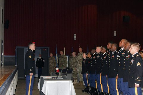Sgt. Travis Bertovich, left, an intelligence analyst with 2nd Battalion, 44th Air Defense Artillery Regiment, 101st Airborne Division (Air Assault) Sustainment Brigade, 101st Abn. Div., stands in front of his newly-inducted peers to initiate the Creed of the Noncommissioned Officer, Feb. 2, 2017, during the brigade's NCO induction ceremony at Wilson Theater, Fort Campbell, Kentucky. Although Bertovich started the creed, all NCOs in attendance recited it with him as part of an NCO tradition. (U.S. Army photo by Sgt. Neysa Canfield/101st Airborne Division Sustainment Brigade Public Affairs)