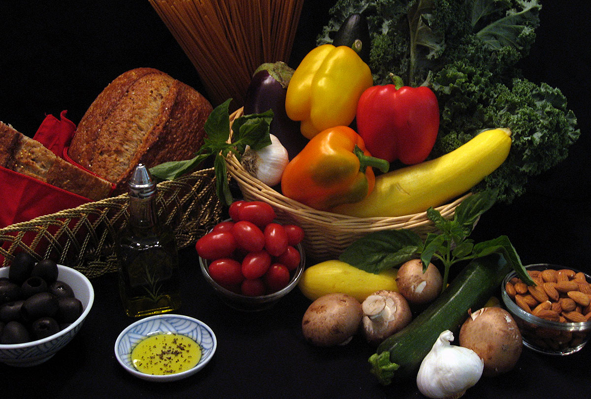 Assorted foods for the Mediterranean Diet - whole grains, olives, olive oil, vegetables, nuts. (American Heart Association)