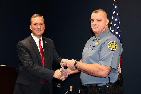 Montgomery County Sheriff John Fuson congratulates Daniel Black