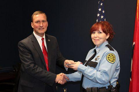 Montgomery County Sheriff John Fuson congratulates Melody Wolfe