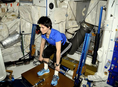 ESA (European Space Agency) astronaut Samantha Christoforetti works out on the Advanced Resistive Exercise Device on the International Space Station. Routine exercise is critical to keeping crews healthy in space. (NASA)