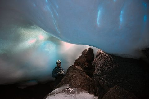 Aaron Curtis, a post-doctoral scholar at JPL, measures gases inside an ice cave. Carbon dioxide levels can be especially high inside the caves, so gas monitors are necessary for safety. (Dylan Taylor)