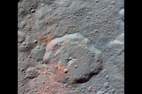 This enhanced color composite image, made with data from the framing camera aboard NASA's Dawn spacecraft, shows the area around Ernutet Crater. The bright red portions appear redder with respect to the rest of Ceres. (NASA/JPL-Caltech/UCLA/MPS/DLR/IDA)