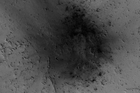 NASA's Mars Reconnaissance Orbiter has been observing Mars since 2006, enabling it to document many types of changes, such as the way winds alter the appearance of this recent impact site. (NASA/JPL-Caltech/Univ. of Arizona)