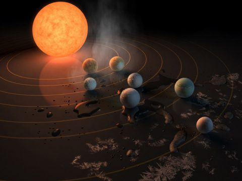 The TRAPPIST-1 star, an ultra-cool dwarf, has seven Earth-size planets orbiting it. This artist's concept appeared on the cover of the journal Nature in Feb. 23, 2017 announcing new results about the system. (NASA/JPL-Caltech)