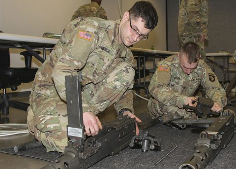 Sgt. Shawn Miller, left, motor transport operator, 2123rd Transportation Company, Kentucky National Guard, assembles a .50-caliber machine gun during a battalion-level master gunner course Feb. 8, 2017, at the Kinnard Mission Training Complex, Fort Campbell, Kentucky. (Sgt. Neysa Canfield/101st Airborne Division Sustainment Brigade Public Affairs)