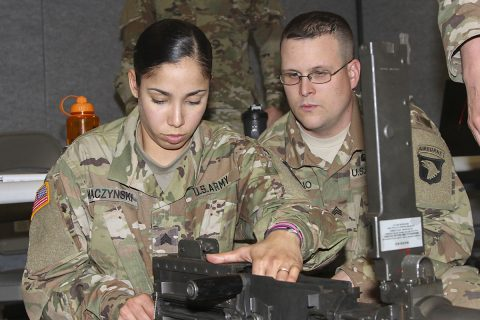 Sgt. Benjamin Rubino, right, motor transport operator, 129th Combat Sustainment Support Battalion, 101st Airborne Division Sustainment Brigade, 101st Abn. Div., watches Sgt. Beatriz Maczynski, left, motor transport operator, 129th CSSB, assemble a .50-caliber machine gun during a battalion-level master gunner course Feb. 8, 2017, at the Kinnard Mission Training Complex, Fort Campbell, Kentucky. (Sgt. Neysa Canfield/101st Airborne Division Sustainment Brigade Public Affairs)