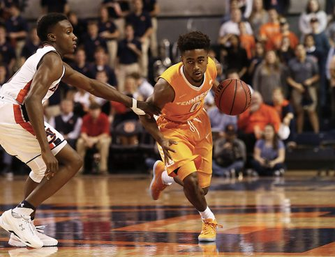 Tennessee Volunteers guard Jordan Bone (0) moves past Auburn Tigers guard Jared Harper (1) during the first half at Auburn Arena. (John Reed-USA TODAY Sports)
