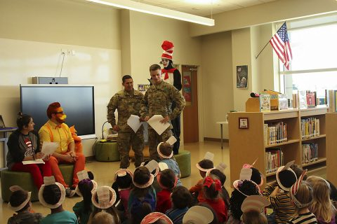 """Two Soldiers from the 716th Military Police Battalion, 101st Airborne Division (Air Assault) Sustainment Brigade, 101st Abn. Div., participate in a rehearsal of """"The Cat in the Hat"""" production staff members of Marshall Elementary School put together for the students, March 2, 2017, at Marshall Elementary School on Fort Campbell, Kentucky. (Sgt. Neysa Canfield/101st Airborne Division Sustainment Brigade Public Affairs)"""
