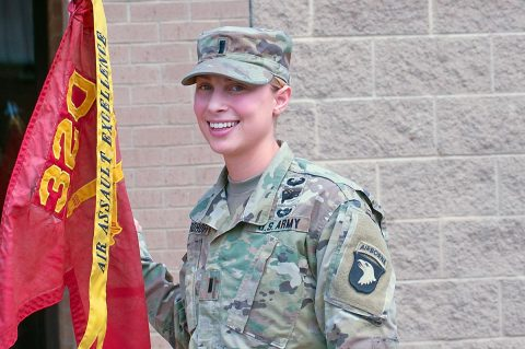 U.S Army 1st Lt. Austen Boroff, platoon leader, Battery C, 1st Battalion, 320th Field Artillery Regiment, 101st Airborne Division (Air Assault) poses near her battery's guidon, Mar 24, 2017, at Fort Campbell, KY. Boroff, a graduate of the United States Military Academy was the first female platoon leader in 1-320th's history to lead Soldiers in a combat environment. (1st Lt. Daniel Johnson)