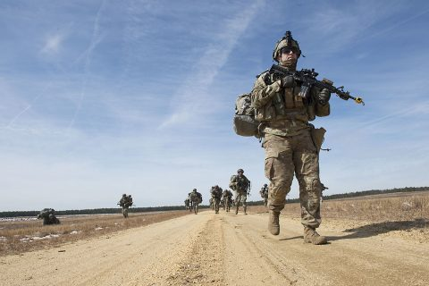 U.S. Army Soldiers from the 101st Airborne Division make their way towards the woods for cover after debarking a UH-60 Black Hawk as they attempt to sieze an airfield during a mobilty exercise called WAREX at Joint Base McGuire-Dix-Lakehurst, N.J., March 13, 2017. (U.S. Air Force Tech. Sgt. Gustavo Gonzalez)