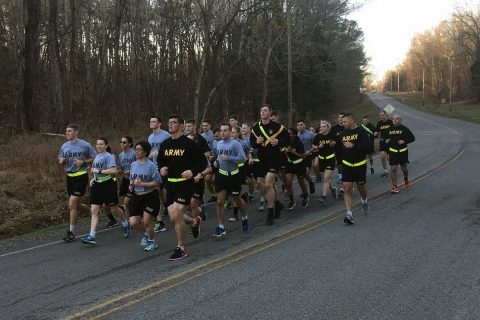 Leaders from 2nd Battalion, 44th Air Defense Artillery Regiment, 101st Airborne Division (Air Assault) Sustainment Brigade, 101st Abn. Div., set the pace during a run with 27 cadets from Wheaton College during a visit to Fort Campbell, Ky., Feb. 24, 2017. (SPC Raymond L. Sanchez)