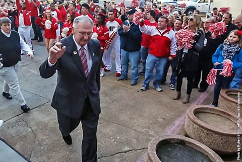 Austin Peay Basketball Coach Dave Loos waves to students as he enters the Dunn Center. (APSU Sports Information)