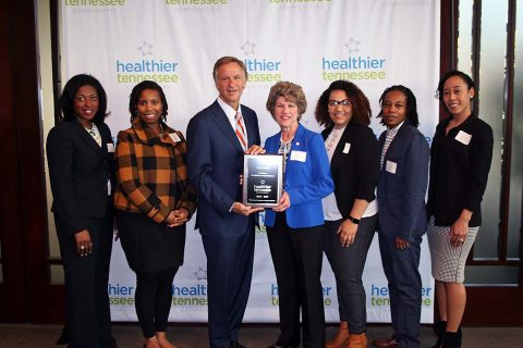 Tennessee Governor Bill Haslam presents a plaque to Clarkville Mayor Kim McMillan and members of the Mayor's Fitness Council/Healthy Clarksville designating Clarksville as a Healthier Tennessee Community.