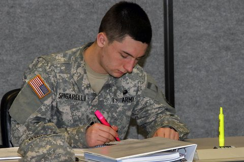 Spc. Domenic Spigarelli, a test, measurement and diagnostic equipment maintenance support specialist with 129th Combat Sustainment Support Battalion, 101st Airborne Division (Air Assault) Sustainment Brigade, 101st Abn. Div., highlights information in his textbook before class Jan. 31, 2017, at the Kinnard Mission Training Complex, Fort Campbell, Kentucky. (Sgt. Neysa Canfield/101st Airborne Division Sustainment Brigade Public Affairs)