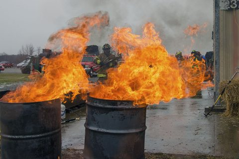 Dave Brasells, president of the Middle Tennessee Fraternal Order of Leatherheads Society, carries wood to burn barrels during a firefighter training exercise Feb 18, 2017, at Fort Campbell. Approximately 50 participants from about 20 fire departments took part in the event.(Leejay Lockhart, Fort Campbell Public Affairs Office)