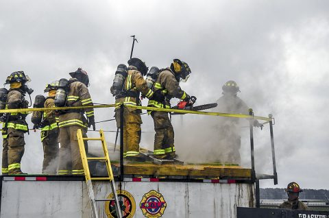 Soldiers assigned to 550th Engineer Detachment, 716th Military Police Battalion, supported at Fort Campbell by the 101st Airborne Division Sustainment Brigade, 101st Airborne Division, perform vertical ventilation training at the second annual Light and Fight Feb. 18, 2017, at the Fort Campbell Fire Training Facility near Campbell Army Airfield. (Leejay Lockhart, Fort Campbell Public Affairs Office)