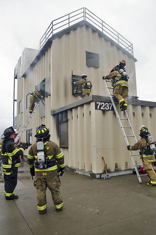 Participants at the second annual Light and Fight regional firefighter training exercise on Fort Campbell demonstrate skills including left hand-right hand search techniques, advancing attack line to seat of fire, using hand tools to open doors, climbing ladder with gear, sounding floor before entry, isolating fire, containing fire, force entry to stairwell then deploy hotel pack from stand pipe and attack fire Feb. 18, 2017, at the Fort Campbell Fire Training Facility. (Leejay Lockhart, Fort Campbell Public Affairs Office)
