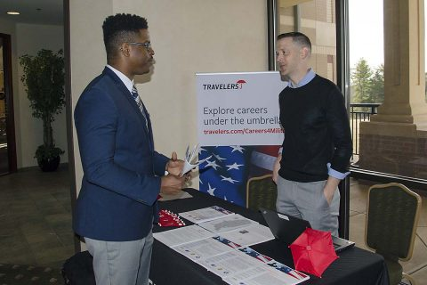 Specialist Avery Harbin, a Soldier assigned to the Warrior Transition Battalion, speaks to Tim Borowski, operations unit manager for Travelers, at the Soldier for Life - Transition Assistance Program and Army Community Service's Employment Readiness Program International and National job fair March 22, 2017, at Cole Park Commons. Harbin will transition from the military to civilian life at the end of August. (Leejay Lockhart, Fort Campbell Public Affairs Office)
