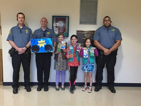 Montgomery County Sheriff Deputies the Girl Scouts delivering Girl Scout Cookies.