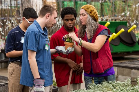 Lowe's employee teaches CMCSS students about caring for plants.