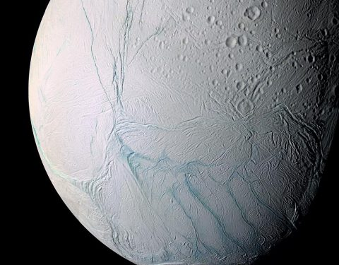 "This enhanced-color Cassini view of southern latitudes on Enceladus features the bluish ""tiger stripe"" fractures that rip across the south polar region. (NASA)"